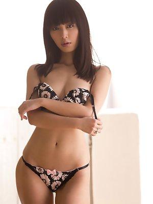 pulls down her flowery panties