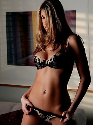 is a classy beauty with a...